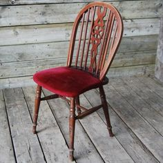 A large quantity of English wheel-back stained ash pub chairs,