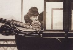 Queen Alexandra in a coach with her pekinese, 1910