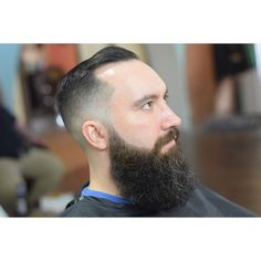 A butter smooth low skin fade and classic pomadour accentuated by a generous beard cut by Pat Hatt http://pathatt.tumblr.com/post/136854447385/cut-on-mr-devine-thanks-man-theblackcomb