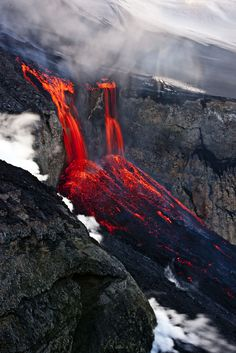 Eyjafjallajoekull Lava Falls - An Icelandic volcano that has been dormant for nearly 200 years has just erupted near the Eyjafjallajoekull glacier sending lava flows down into the valley.
