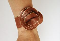 Leather jewelry is trending and this Brown Leather Flower Cuff bracelet is going to be a statement piece in those leather jewelry lover's collections.