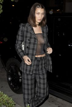 Stunner: The supermodel commanded attention in the eye-popping black and white plaid suit ... #bellahadid