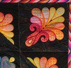 Heather Feather, Detail 2 | Textile Treasures | Nancy WickVIEWER'S CHOICE award winner at Minnesota Quilt Show 2011; Pieced, embroidered, and quilted by Nancy Wick; Design source for embroidery = Heather Feather by Sarah Vedeler; Applique fabric is hand painted by Nancy Wick