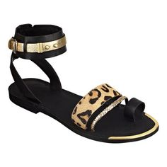 "As seen in the April issue of People Style Watch,,,,,Toe ring 1/4"" sandal with adjustable ankle buckle closure.  Dual banded front with metal accent.  Leather upper."