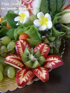 fruit and vegetable  flora arrangements   Fruit garnish details, exotic flower (kiwi and red apple)