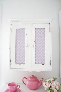Chicken wire and fabric on jelly cabinet window - nice!!