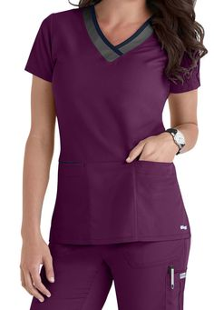 LEADER OF THE PACK | Grey's Anatomy shows off subtle style with contrasting colors on the neckline and pockets for this terrific scrub top (in Romance). This top gives you a perfectly professional look with that perfect touch of detail. Over a dozen color options let you stand out from the crowd, and you can tuck your cell phone away in a special pocket-in-a-pocket.