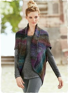 A soft, substantial layer, rib knit in a gradation of hand-painted amethyst, fuchsia, charcoal and teal yarns, our cozy alpaca (60%) and wool (40%) cocoon cardigan has drop shoulders, a shawl collar and rounded hem.