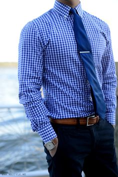 gingham blue check oxford. solid blue tie. silver tie bar. blue pants. brown leather belt. watch. versatile. style.