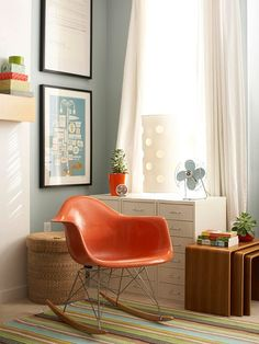 Turquoise and orange - I'm so drawn to both colors, together or separately! LOVE that chair and those nesting tables.I need to get me some nesting tables! Eames Rocker, Eames Rocking Chair, Ideas Prácticas, Den Ideas, Ideas Para, Sectional Furniture, Light Grey Walls, Cafe Chairs, Nesting Tables
