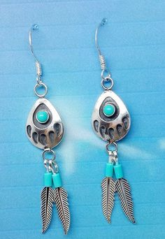 Zuni Stirling  earring with Silver and Turquoise Bear Paw with Silver feathers.