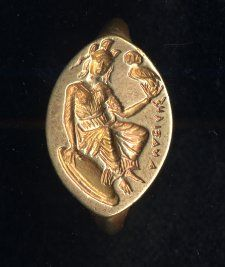 """Gold signet ring: on the bezel Athena seated with an owl; the Greek inscription reads """"Anaxiles"""",ca. 400 BC."""