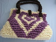 "Echoing Heart Tote Crochet Pattern - Yahoo! Voices - this would be cute with different colors of red & pink for the heart ""rounds"" on a black or navy background"