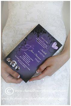 Bride holding wedding invitation.