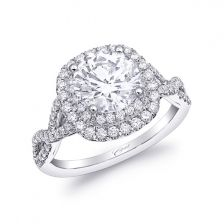 This stunning engagement ring features a double halo of diamonds framed by a twisted diamond shank. Created for a 2CT center stone. Coast Diamond, #LC10029