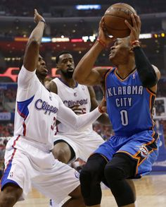 Oklahoma City's Russell Westbrook (0) is defended by Los Angeles' Chris Paul (3) and DeAndre Jordan (6) during Game 3 of the Western Conference semifinals in the NBA playoffs between the Oklahoma City Thunder and the Los Angeles Clippers at the Staples Center in Los Angeles, Friday, May 9, 2014. Photo by Nate Billings, The Oklahoman
