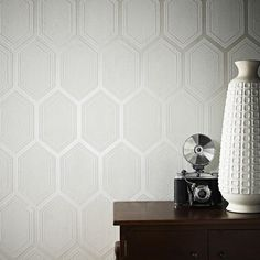 Chamonix is a great large scale geometric wallpaper design with an added pearlescent shine in the main body of the pattern. A really bold design in this subtle color pallette will make a really stylish impact in any room of any home.