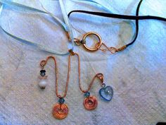 Blue and brown ribbon necklace with blue heart and angel by rowdylady, $20.00