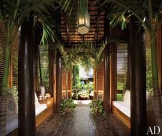 The entranceway to Casa Grande Framina in the Dominican Republic features flooring made of railroad ties.