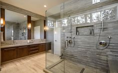 These linear #tiles give a great spa feel to this bathroom! I have shower envy here!! #TileSensations