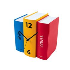 Book Table Clock - The hours are cleverly disguised as book titles and looks like an actual set of books
