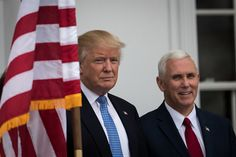 BEDMINSTER TOWNSHIP, NJ - NOVEMBER 20: (L to R) President-elect Donald Trump and vice president-elect Mike Pence listen to a question from the press regarding the musical 'Hamilton' before their meeting with investor Wilbur Ross at Trump International Golf Club, November 20, 2016 in Bedminster Township, New Jersey. Pence was booed when he attended the Broadway musical and a cast member read him a message after the show. Trump and his transition team are in the process of filling cabinet and…