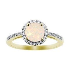 Grandmothers opal ring reset with two layers of diamonds around it and a diamond band.