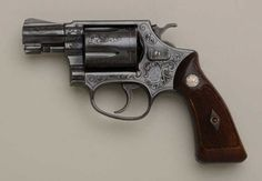 Smith & Wesson Model 36 Chiefs Special with  2  barrel in .38 special cal., factory  engraved, blued