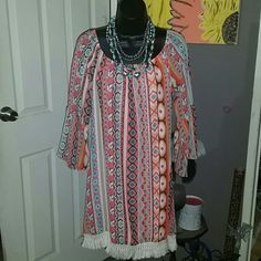 Pretty Dress NWOT Cute Santa Fe print dress it is knee length with wide sleeves.  100% polyester Dresses Long Sleeve