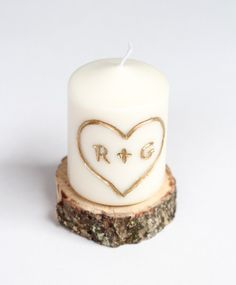 I mean, they already have our initials on it and everything.  Carve into a candle, fill with gold leaf pen.