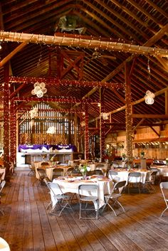 barn decor: small lights around the posts and beams are a nice touch for a barn event or wedding