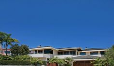 Located in a quiet cul-de-sac, this distinctive 4-bedroom, 4-bath home boasts stunning ocean and coastline views.