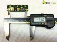 Der Abstand der Bohrungen liegt bei 48,4mm - die Bohrungen selber haben einen Durchmesser von 3,1mm und einen Radius von 1,55mm