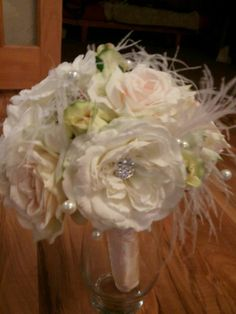 Fake flowers bouquet with feathers and sparkle goodies