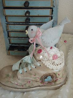 Birdie on pincushion by lauriescharmingdesigns