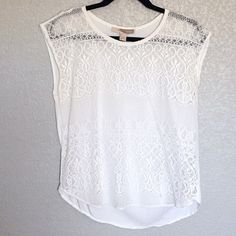 """WHITE LACE BLOUSE White lace blouse. Measures *approx. 24"""" length (measured flat). shell 1: 100% nylon/polyamide, shell 2: 100% rayon. Condition: gently used, light stain on lower hem area and light discoloration stains at underarm areas. Just needs to be cleaned (reference pics). Sold AS IS. Final sale.  ❌NO TRADES ❌No Offsite Transactions  ✅All Price Negotiations are handled strictly through the OFFER Feature Only. Lowball offers will be ignored Tops Blouses"""