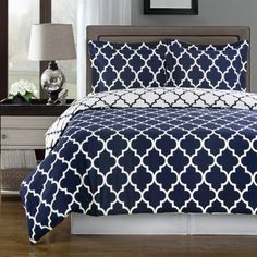 navy and white patterned bedding; pair with my grey walls and coral accents! lnt.com