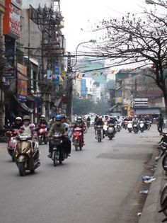 Hanoi, Vietnam.  Not the friendliest city I've been, but this photo def jogs my memory.  All I remember is motos everywhere.