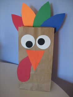 Very simple three-step craft - draw or trace your turkey pieces, cut them out, and glue them onto the bag!