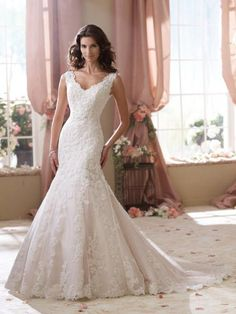 David Tutera -Sleeveless hand-beaded lace, point d'Esprit and organza modified mermaid wedding dress with front and back V-necklines, plunging V-back finished w
