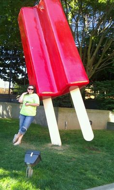 A geocaching friend doing a waymarker in Seattle Washington. This giant popsicle is the creation of lifelong artist Catherine Mayer. It was installed in Spring of 2011 and has been a popular stopping point for tourists and city denizens alike. Someday I want to have my picture take with it ...