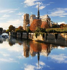 Notre Dame with boat on Seine in Paris, France stock photo France Photos, Archangel Michael, Paris France, Notre Dame, Taj Mahal, Boat, Stock Photos, Building, Travel