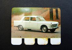 "Peugeot 404 vintage french car, metal made image, from the serie ""the car…"