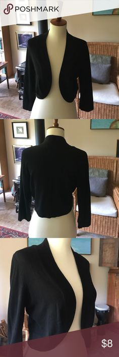 Black Cropped Cardigan Jersey knit, black, cropped cardigan. Form fitting, goes well with many other pieces. Excellent condition, worn one time. Open front, hits at top of hip. Jessica Howard Sweaters Cardigans