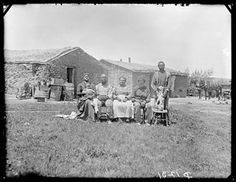 The Shores family near Westerville, Custer County, Nebraska, 1887. Pictured (l - r): Minerva (with the infant), Rev. Marks, Rachel and her husband Jerry and their son, Jim Shores. The younger members of the family were noted musicians.  Photo by Solomon Butcher.