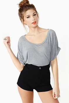 being short, the more skin the better. high waisted shorts, loose tee. adorable and easy. love the eyeliner too.