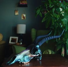 A commissioned iridescent antelope skull inspired by the Japanese beetle. Hand painted and made with love for Rosie.