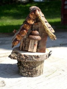 Handcrafted whimsical birch bark fairy house, complete with stand.  Decorated on both sides giving you two different looks, unique.    size approx 4.5