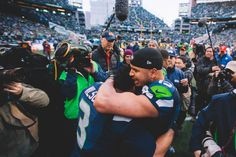Russell Wilson and Jermaine Kearse embrace after emotional overtime win in the NFC Championship game.  www.jeffmarsh.com