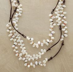 """Lively Pearl Necklace  Three strands of cultured Keshi pearls, two sparked with cubic zirconia in a host of vibrant hues. Leather cord; sterling silver toggle clasps. Handmade. Exclusive. 18""""L."""